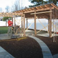 Build: Christain building the framework for the pergola and outdoor structure