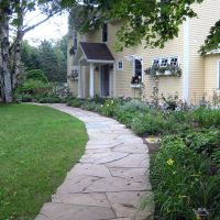 Define your lawn with a stone walkway perimeter