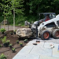 Installation: Installed a bluestone walkway, moved boulders from the site to give a woodland feel.  Plants are being laid out to be planted.