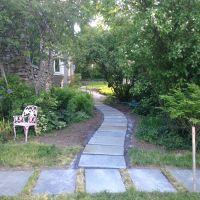 Install: Installing the serpentine Bluestone walkway through the shade garden