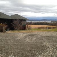 Before: parking area with a beautiful view of Lake Champlain and the Green Mountains.